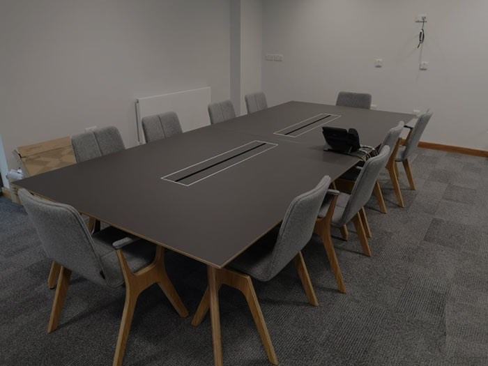 Furniture install into a office room by WG Relocations.